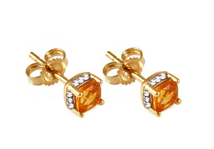 Gold earrings with brilliants and citrins