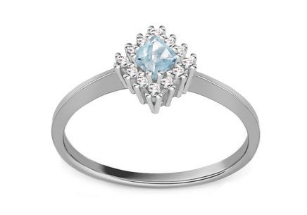 Gold Ladies Ring with Light Blue Zircon