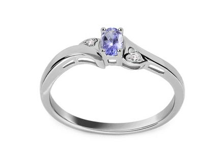 White gold engagement ring with tanzanite and 0.010 ct diamonds