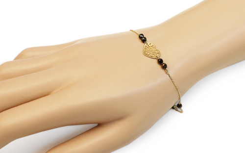 Gold bracelet with pendants and black zircons - IZ15636 - on a mannequin