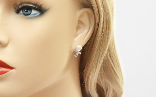 White Pearl earrings on 925Sterling Silver decorated with cubic zirconia