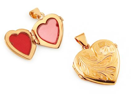 Gold decorated heart shaped medallion with flower engraving for a photo