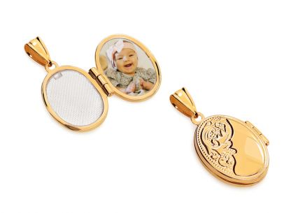 Gold oval photo medallion with ornamental pattern