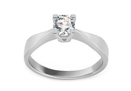 Silver engagement ring with central zircon