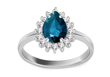 Gold ring with dark blue and clear zircons