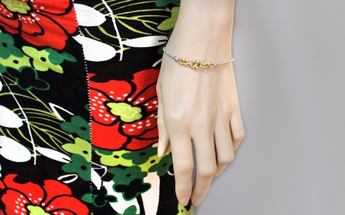 Sterling Silver bracelet with gold trimmings - IS535NY - on a mannequin