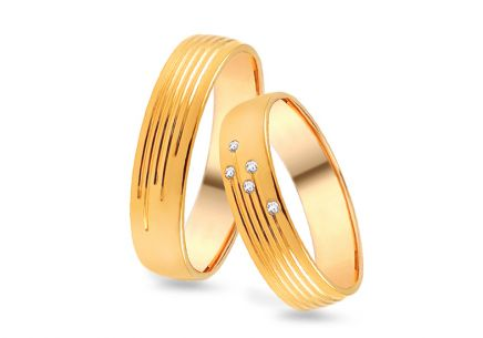 Wedding rings gold with zircons width 4 to 8 mm