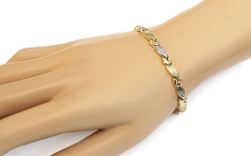 Women's Two Tone Gold Bracelet - IZ10915 - on a mannequin